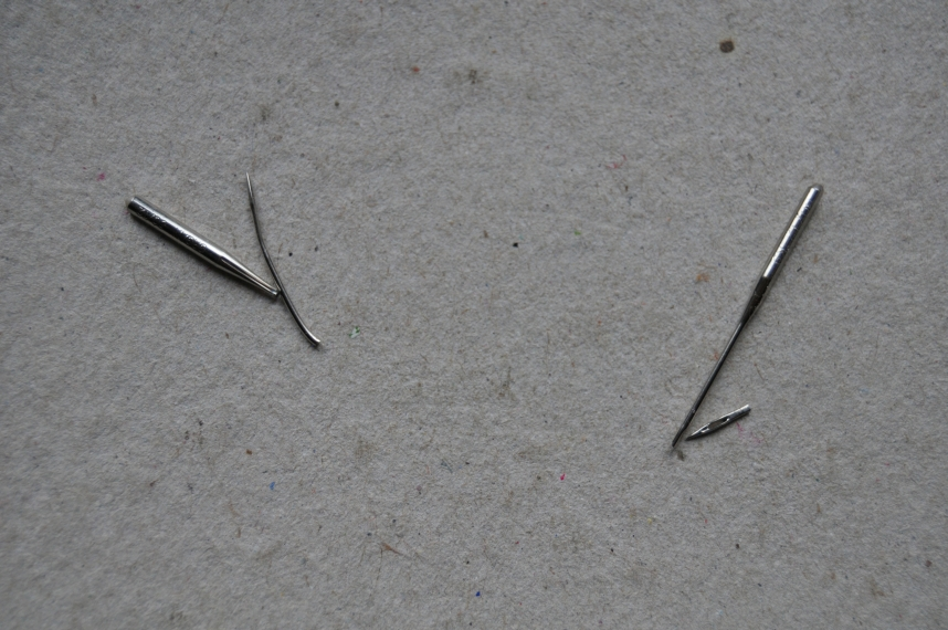 Left:  An 80/12 needle broken due to thread wrap.  Right: An 80/12 metallic needle broken due to WTF?